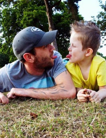 Father and son playing in a field